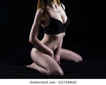 Photo of sitting woman in sexual lingerie