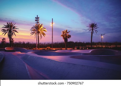 Photo of a skate park in the dusk.