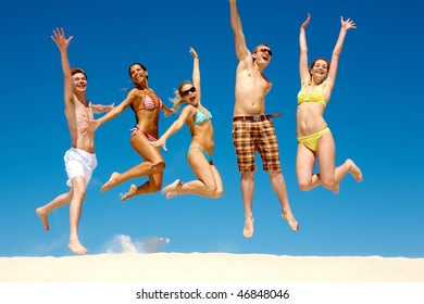 Photo of slim energetic people jumping and screaming at summer