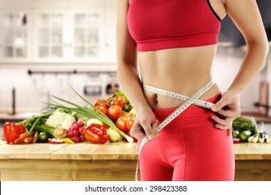 photo of slim woman and white kitchen