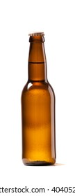 Photo of an small Bottle of beer white background isolated . Studio shot indoors No Lebel
