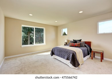 Photo of a small craftsman master bedroom with beige walls and carpet. Northwest, USA.