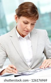 Photo of smart businesswoman working in office