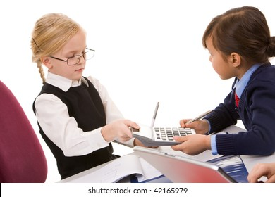 Photo of smart girl giving calculator to her friend