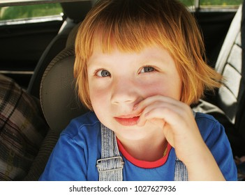 Photo of a smiling girl Roksolana, which looks out of the window of the car