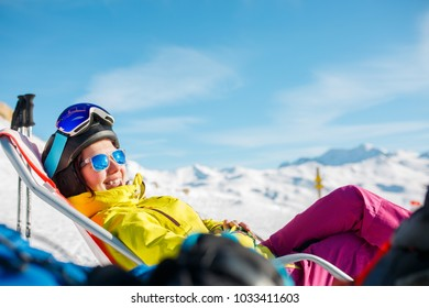 Photo of smiling sports woman lying on winter deckchair