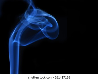 Photo of smoke creating interesting flows, curves, lines, spirals and patterns.
