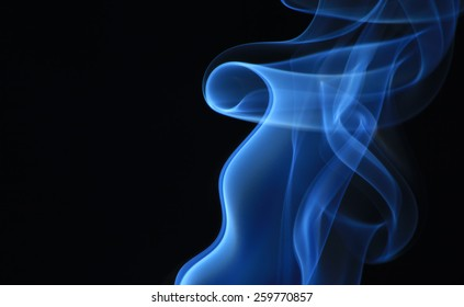 Photo of smoke creating a variety of smooth curves, spirals and flows on black background