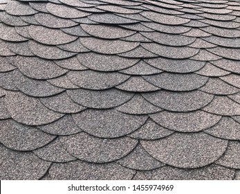 Photo of soft shingles tiles. Texture of the soft roof. Roofing, made of shingles. Texture of shingles. Background on the topic of roofing construction materials.