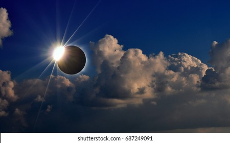 Photo of solar eclipse and cloudy sky, natural phenomenon
