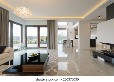 Photo of spacious expensive living room with shining marble floor