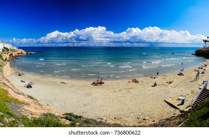 Photo of Spain's natural landscape with the sea and the beach, blue sky and beautiful white clouds