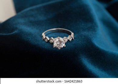 photo of sparkly lady's ring on velvet fabric
