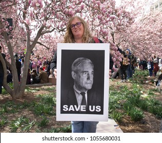 "A photo of Special Counsel for the Justice Department Robert Mueller, along with the words, ""Save Us"" are on a sign held by a participant at the March for Our Lives in Washington DC."