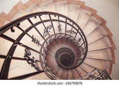photo of a spiral staircase in an old house