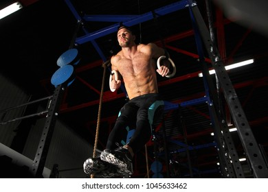 photo of a sports guy on rings