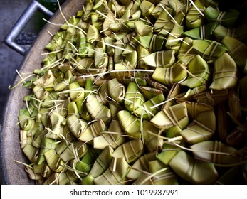 Photo of stack of uncooked Filipino delicacy called Suman or glutenous rice