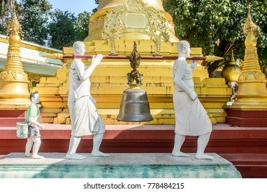 photo of statue, copper bell is carrying by whiterobed deacon, culture of Myanmar, Dec-2017