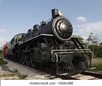 Photo of a steam locomotive engine circa 1890's-1910's that was used in the Florida Railway System.