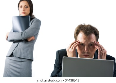 Photo of stressed businessman looking at laptop screen with troubled female at background