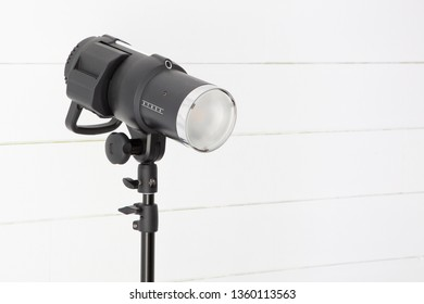 photo studio flash projector on wood white background