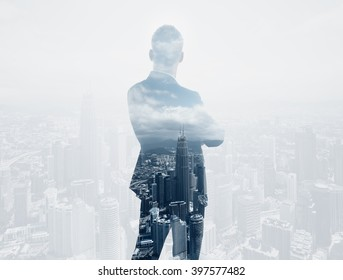 Photo of stylish adult businessman wearing trendy suit and looking city. Double exposure, panoramic view contemporary City background. Horizontal