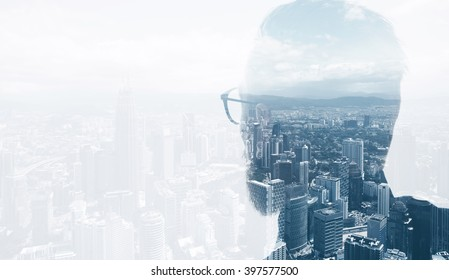 Photo of stylish bearded lawyer wearing trendy suit and looking city. Double exposure, panoramic view contemporary City background. Space for your business message. Horizontal