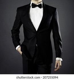 Photo of stylish man in elegant black suit