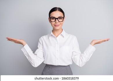 Photo of successful business girl presenting two palms empty space wear glasses white shirt isolated grey color background