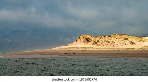 photo of sunlight hitting a dune