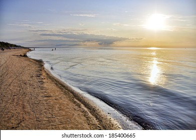 Photo of a sunset at the beach in Jurmala, Latvia.