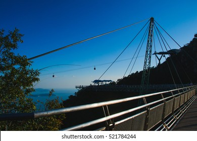 Photo of the Sunset time on Sky bridge symbol Langkawi island. Adventure holiday. Modern construction. Tourist attraction. Travel concept. Cable car
