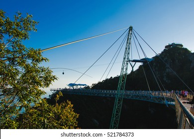 Photo of the Sunset time on Sky bridge symbol Langkawi island. Adventure holiday. Modern construction. Tourist attraction. Travel concept.