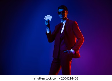 Photo of sweet adorable guy dressed formal suit glasses smiling holding playing cards gun isolated gradient blue color background