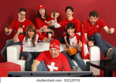 Photo of Swiss sports fans watching television and cheering for their team. Hopp Schwiiz!