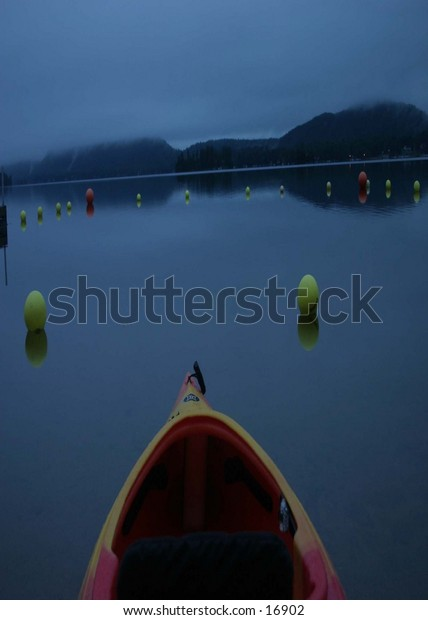 photo taken from back of canoe looking ahead empty lake no body around