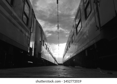 Photo taken between 2 train in sunset. Black and white photography.