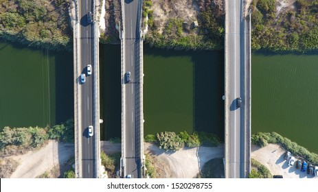 photo taken from a bird's eye view in the daytime in Israel.  The photograph shows the bridges over Alexander Creek