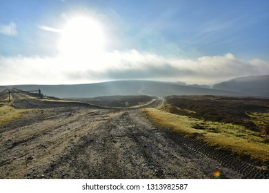 Photo taken in the early morning on the North York Moors, England, at Bloworth Crossing, featuring Rutland Rigg (path) heading off into the distance backed by the last remainder of the sunrise.