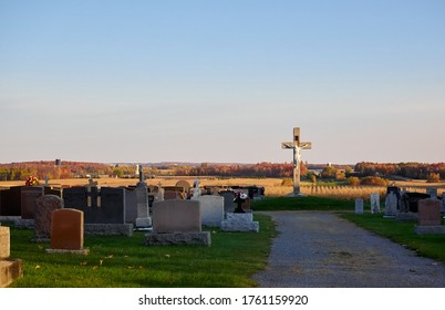 Photo taken in the fall in a small village in Quebec. We can see the fields in the distance and the trees with orange leaves. Beautiful landscape. Ulverton, Quebec, Canada; October 19, 2018.