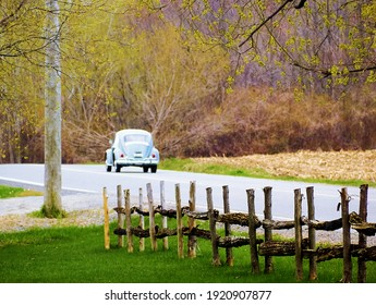 Photo taken in spring, nature was starting to wake up. The wooden fence adds a touch of nostalgia. Quebec, Canada, May 9, 2020.