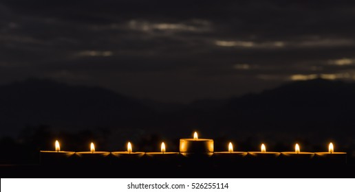 The photo was taken at sunrise using nine burning candles as foreground for inspiration  Jewish symbol for Hanukkah holiday. Selective focus