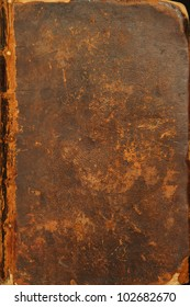 Photo of the tattered cover of a bible from 1786.