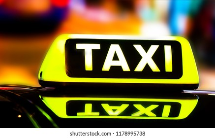 """Photo of a taxi car with blowing sign """"Taxi"""""""