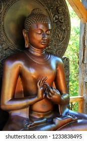 Photo of teaching Buddha (DharmaChakra Buddha) statue. This statue signifies wisdom, understanding, and fulfilling destiny.