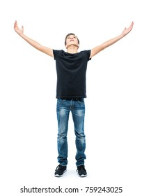 Photo of teen boy with raised hands up posing at studio over white background