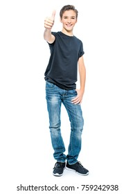 Photo of teenage boy with thumb up - looking at camera.