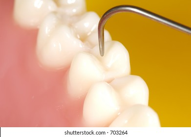 Photo of Teeth and a Dental Probe.  Dental Concept