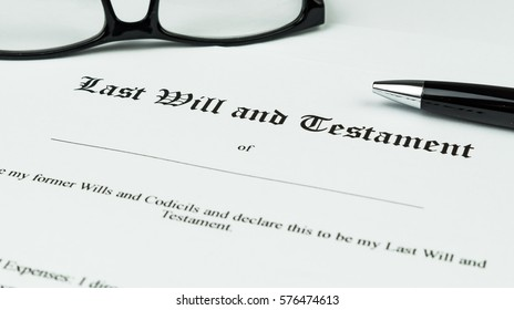 Photo of a Testament, with glasses and pencil