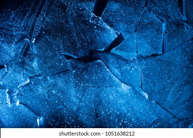 Photo texture of a blue toned frozen ice cubes background.